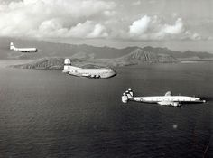 This is a starboard side view of three aircraft in flight. The three are all from the Pacific Division of the Military Air Transport Service. Front to rear are an Lockheed R7V Constellation, then a Douglas C-124 Globemaster II (s/n 51-101), and then a Boeing C-97 Stratofreighter. (U.S. Navy photo)