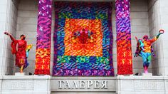 """Olek Crochets Rainbow Yarn Installation On Building Facade in St. PetersburgAccording to the artist, the installation's rainbow theme stands for """"love, freedom, friendship, independence, liberty, ability to pursue dreams, integrity, and equal rights."""""""
