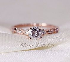 Rose gold delicate engagement ring