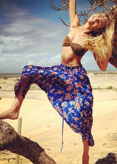 Candice Swanepoel floral skirt and body chain