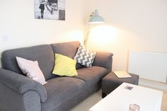 This IKEA Tidafors sofa looks great with colourful cushions and this duck egg blue floor lamp! I love my living space! Source: http://www.fayesfix.com/2015/01/introducing-flat.html