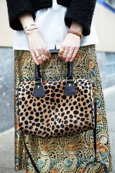 619f363b7250 Christene mixes patterns with a Clare Vivier duffle bag. Photo by Bek  Andersen. Clare