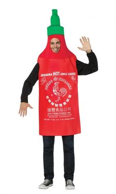 Adult size Sriracha Tunic Costume - Foodie Hot Sauce  You can look like your favorite bottle of Hot Sauce this Halloween with this Sriracha Adult Costume!  The costume includes a red tunic shaped like a giant bottle of Sriracha hot sauce. The tunic features screen print logo and attached green cap.  Does not include shirt, pants or shoes.  One Size Fits Most