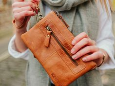 This leather wristlet clutch is handcrafted from our soft antique leather. The tan leather clutch comes in a delicious caramel colour and is slightly distressed for a truly vintage look. Leather Hobo Bags, Leather Saddle Bags, Leather Pouch, Tan Leather, Leather Handbags, Handbags Uk, Leather Keychain, Womens Purses, Leather Accessories