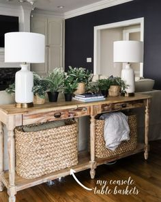 Everett Console Table with console table baskets, white lamps, faux plants and hale navy walls in living room Sofa Table Decor, Couch Table, Table Decorations, Table Behind Couch, Home Furnishings, Home Furniture, Antique Furniture, Living Room Decor, Living Room Table Lamps