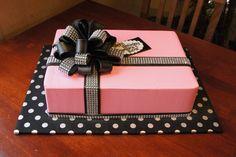 Pink buttercream gift box birthday sheet cake with black bewjeweled fondant bow