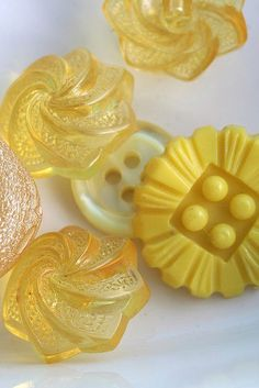 bunnycottage.quenalbertini: Vintage yellow buttons