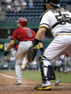 Arizona Diamondbacks' Adam Eaton (6) heads to first in front of Pittsburgh Pirates catcher Russell Martin after hitting a single, driving in two runs, in the 16th inning of a baseball game on Sunday, Aug. 18, 2013, in Pittsburgh. The Diamondbacks won 4-2 in 16 innings The Associated Press