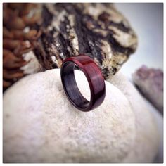 This is our first Burmese Padauk and Ebony bent wood ring. Chosen for their highly contrasting and deep hues, both woods complement each other perfectly with their rich colours. A CA Glue finish is applied in multiple layers to the outside surfaces, which is then sanded and polished to form a high gloss, water resistant finish.  We can produce rings to a wide range of ring sizes, so please do not hesitate to contact us directly with your precise ring measurements…