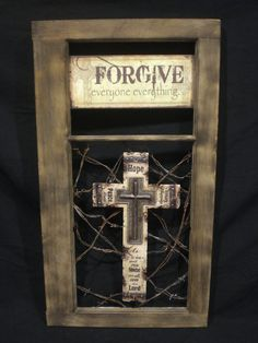 Hope Cross on bed of barbed wire mounted in vintage window frame with tin sign..