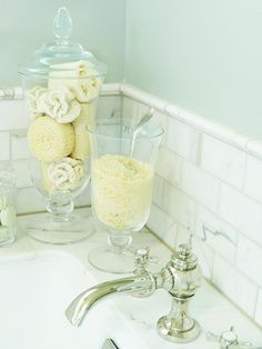 Simple Indulgence  A vintage silver soup ladle serves bath salts right out of a glass decanter and into the tub. Shapely glass jars -- a mix of family heirlooms and new vessels from discount stores -- show off salts, sponges, and cotton balls.