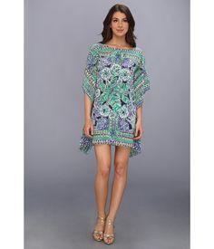 Resort chic at its finest.. Short caftan dress in printed silk de chine.. Bateau neckline.. Elbow sl...