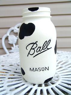 Cow Print Mason Jars for western party. Only paint black spots to make removal easier. Can fill with milk for white part.