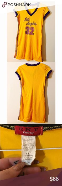 """Vintage 90s Yellow Jersey Dress Amazing, perfect, super awesome yellow 90s netted mesh jersey dress with stripes down the side. Says """"Los Angeles 32"""" with purple elastic and v next. Rare and hard to find!! Lakers LA basketball jersey dress trendsetter Lebron Vintage Dresses"""