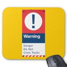 WARNING ! DANGER ! Do Not Cross Tracks ! Mouse Pad - This Safety Sign is posted by Amtrak to remind people that HIGH SPEED PASSENGER TRAINS use these tracks. The Acela Express can travel up to 150 MPH