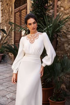 The aristocratic style of the dress Michela is emphasised by its conspicuous demureness, although the thinnest flowing fabric tastefully accentuates e. V Neck Wedding Dress, Long Sleeve Wedding, Best Wedding Dresses, Bridal Dresses, Wedding Gowns, Prom Dresses, Elegant Dresses, Beautiful Dresses, Designer Dresses
