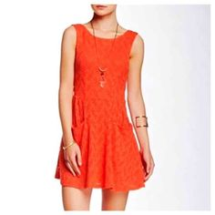 ✨NWT✨ Free People Lace Mini Dress Persimmon NWT! Adorable Free People lace dress in persimmon(it looks red in my pics, but it's more orange/coral in person). Button back closure. Two front pockets. Machine washable. 33 inches in length. Bust(armpit to armpit) is 14 inches laying flat and stretched to 18 inches. No Trades, Price Firm unless bundled*** Free People Dresses Mini
