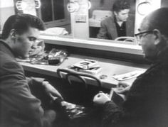 Elvis backstage in New York, meeting with a jeweler. He buys his first diamond ring: the horseshoe ring you can see in so many of the pictures taken of him in 1956. He bought it for luck..........(Wertheimer)
