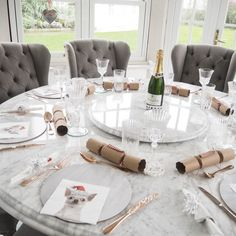 Christmas at Chouquette's - Bespoke marble dining room table made by MARB ONYX and Pepper Mill Antiques chairs