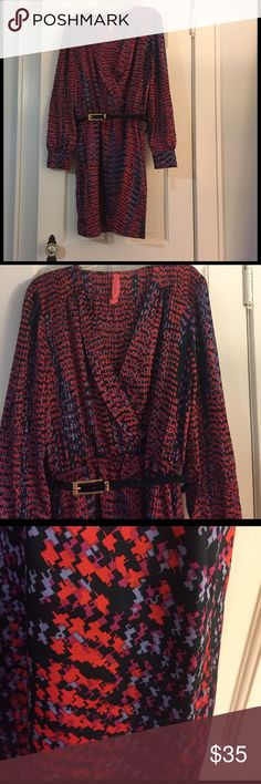 Cute and fun work or going out dress Never worn, with tags, multicolored pattern with orangey red, blues and purples. Skirt comes to about mid thigh (I'm tall). Patent leather belt with gold hardware comes with it. Front looks like it could be a wrap dress. Eight Sixty Dresses Mini