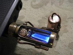 This awesomely steampunk USB drive has a crystal inside that lights up blue when you plug it in.