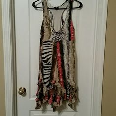 Daytrip Dress Mixed pattern size Large dress. Hits right above the knee for a 5'5 gal. Zebra,cheetah, safari inspired colors. Super cute for a casual wedding or a date night in the summer. Daytrip Dresses Midi