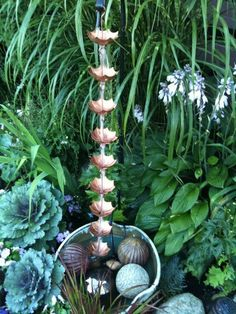rain chain, an interesting and pretty option for directing water from your roof to exactly where you want it down below. Side Garden, Rain Garden, Garden Path, Japanese Rain Chain, Amazing Gardens, Beautiful Gardens, Small Patio Spaces, Outdoor Spaces, Outdoor Decor