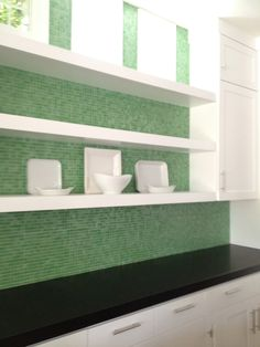 Trend Glass mosaic backsplash and black honed granite counter top.  By Kathleen DiPaolo