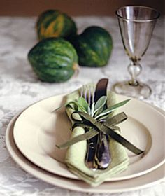 Natural elements can be enchanting additions, like a sprig tucked into a pretty ribbon fastening the cutlery