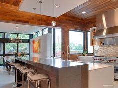luxury kitchen with wood covered walls