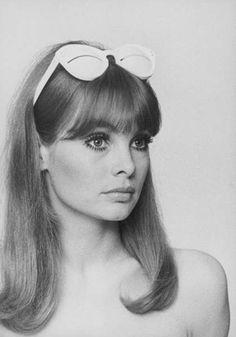 Jean Shrimpton. Showing Courreges sunglasses. In 1966. By Peter Knapp.