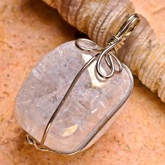 Checkout this amazing deal Natural Rainbow Crystal with 18KT White Gold Plated Wire Wrapped Pendant,$10