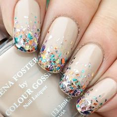 LOVE these nails!! - Nude base with multicolored, confetti-like tips.