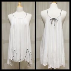 White Boho Dress Size Medium BNWT White Hi Lo Boho Dress Size Medium BNWT You can wear this 2 ways, either as a short mini dress or as a long tunic tank. Thanks for Looking! ⛔️No PP/Trades✅Offers Considered ✅Bundle Discounts April Spirit Dresses High Low