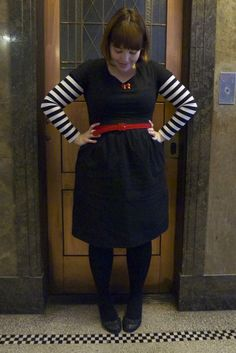 Black dress + black tights & shoes + red belt + red necklace + striped long sleeved tee