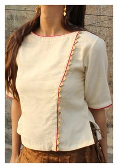Nomad offers a unique collection of Handmade Tops and Cotton Blouse online. Shop for different styles like Floral Cotton Blouse, Chanderi blouse, Cotton crop top etc. Short Kurti Designs, Simple Kurta Designs, Blouse Neck Designs, Cotton Tops For Jeans, Cotton Crop Top, Cotton Skirt, Stylish Blouse Design, Designs For Dresses, Latest Top Designs