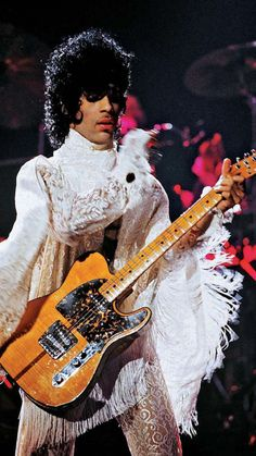 Strapped 2 the body, makin' love 2 the strings   Prince & his Hohner