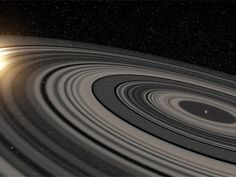 Artist's concept of the rings of J1407b. - An extrasolar planetary ring system discovered in 2012 has now been determined to be much more massive than the one orbiting Saturn.