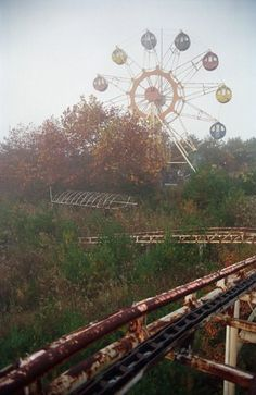 Abandoned amusement park in Tohoku, Japan. View of the Ferris wheel.
