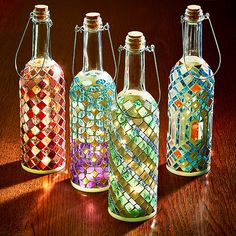 Buy the Wine Bottle Mosaic Lanterns Set at Wine Enthusiast – we are your ultimate destination for wine storage, wine accessories, gifts and more! Wine Bottle Chimes, Wine Bottle Garden, Glass Bottle Crafts, Wine Bottle Art, Painted Wine Bottles, Lighted Wine Bottles, Glass Bottles, Wine Bottles Decor, Alcohol Bottle Crafts