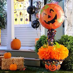 Our no-carve pumpkin decoration will welcome all to your Halloween party! Attach a pumpkin foil balloon to a stake, then decorate with tinsel garland & fully pumpkins! Add pumpkin cutouts to your planter for an extra cute detail!