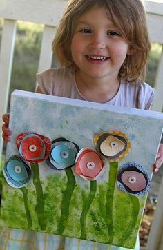 kid crafts: Flower canvas.  Buy a cheap canvas at the craft store (or make one from an old piece of clothes), add paint, then add blooms with cut up paper or fabric scraps.  Hot glue or sew them down and add a button.  BEAUTIFUL!