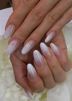 white ombre nails with gold glitter new years eve nail art