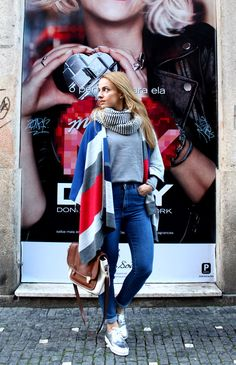 street style. skinny jeans and cape