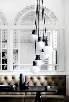 Contemporary meets vintage...don't like tha couch or table. LOVE the window and lights!