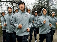 The boys jogging and looking all cool and mysterious in their matching hoodies