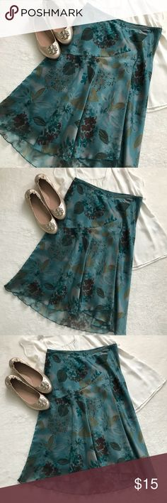 """🎉HP!!🎉Flowy skirt in blues and browns 🎉🍾Host pick 1/31!!🍾🎉Lightweight skirt with a flowy outer layer and slip underneath. The front is about 23"""" long and the back is about 26"""". See my other listings for Express top and Tory Burch flats! Wrapper Skirts"""
