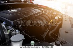 Closeup detail of car engine with soft-focus in the background. over light