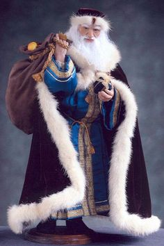 """Wenceslas Santa    Artist: Jan Coe    Third place in the 2004 ProSculpt Scholarship Award contest. Sculpted in ProSculpt, the body is soft-sculpted in fine cloth and fur over a wire armature. This doll is featured on the cover of """"Christmas Dolls"""" book."""