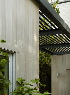 House of architect Cary Bernstein- nice timber panelling contrast for alfresco to black steel